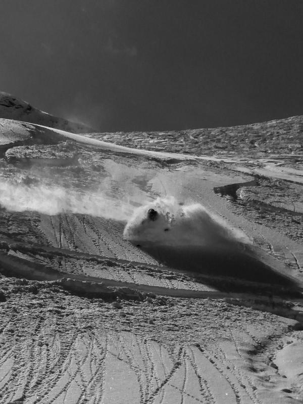 LGA Owner & Guide Jeff Robertson skiing deep powder in the Engelberg backcountry