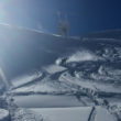 LGA Owner Crystal Robertson snowboarding deep powder on the Steinberg in Engelberg Switzerland