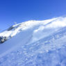 LGA Owner & Guide Jeff Robertson skiing deep powder in the Steinberg in Engelberg Switzerland